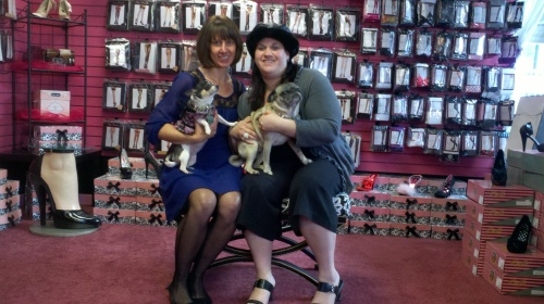 The owners and pups of Aella Boutique